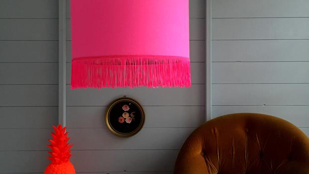 This beautiful silhouette lampshade is made by using an on-trend tropical print wallpaper on the inside of the shade and a neon pink cotton on the outside, €40.53; lovefrankie.com