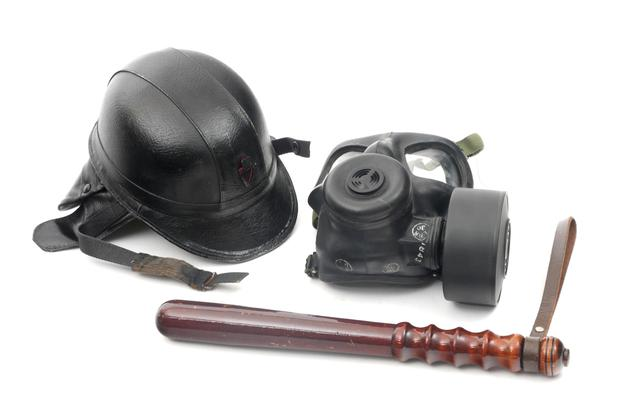 A helmet, gas mask and truncheon