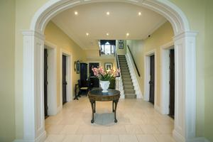 The elegant hallway is typical of a Georgian hallway, with its cross motif. It is floored in Portland stone