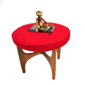 Astro stool by G Plan recovered in red Kvadrat Danish wool, €265, from Kirkmodern