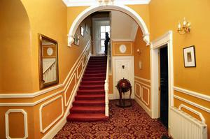 The hall and stairs of Portlick House