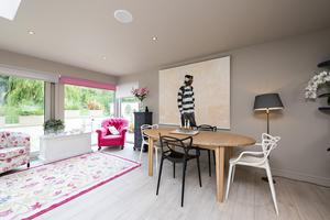 The open-plan dining room/kitchen leads out to the terrace of No10 in Glasnevin, where owners can enjoy views of the park and Tolka River. Photo: Tony Healy