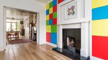 Coloured fitted storage panels make this a fun and bright reception room