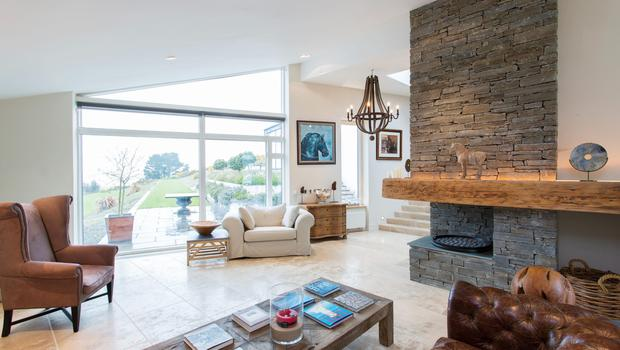 A stone fireplace is the focal point of the living area.