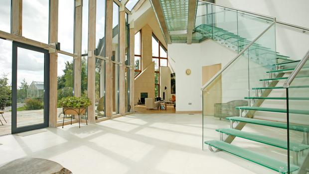 The glass staircase in daylight at 6 The Demense