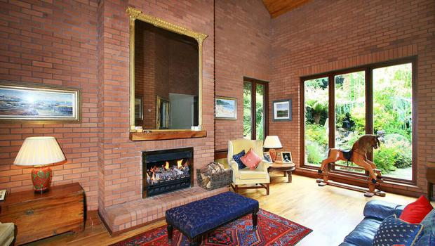 A reception room at Bremac with red brick walls and timber ceiling