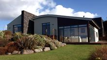 The house in Killorglin, Kerry with views of Caragh Lake and Dingle Bay.