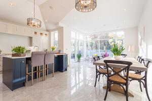 Each of the two homes at Dartry Lodge has a substantial open-plan kitchen, dining room and living room/conservatory with a porcelain Marfil tile flooring