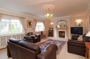 The extra large living room with red brick fireplace