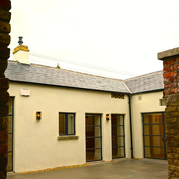 AFTER: An old stone coach house renovation by de Blacam and Meagher; lime render allows the walls to breathe.