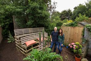 Lisa McNamee and David Harte in the garden of their unique home — which includes an outdoor cinema area and tree house for parties