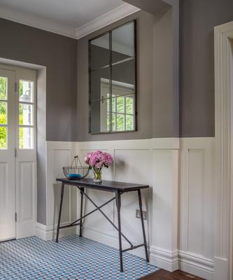 Paint panelling, architraves and doors all the same shade to unite a space.