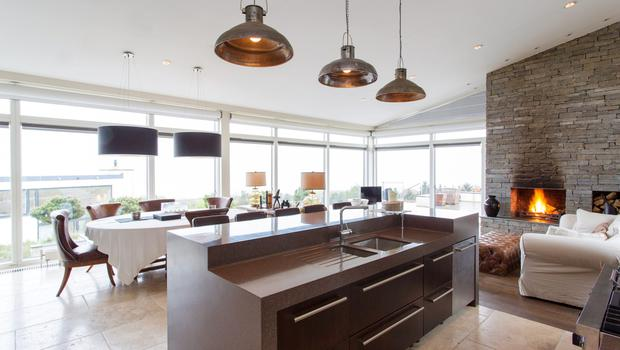 The large family and entertaining space enjoys exceptional views thanks to full height windows