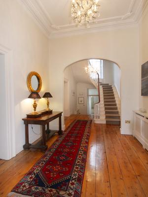 The entrance hall retains the original floorboards
