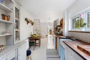 The stairs in the kitchen of No31 Park Lane, Sandymount, leads to two bedrooms