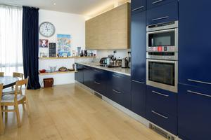 The navy kitchen is situated to the front of the living room, which Liz says is 1,000 square feet and possibly the biggest living room in a private home in Dubli