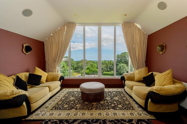 Room with a view: The mezzanine area of The Old Fieldstown Schoolhouse was once home to the master bedroom but is now a relaxation and viewing lounge