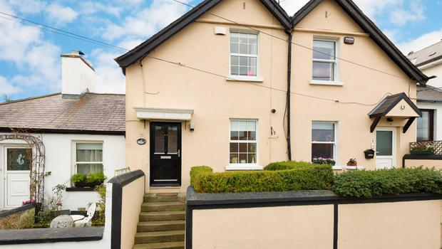 Number 8 is a two-storey, two-bedroom cottage in Killiney with a floor area of 926 sq ft
