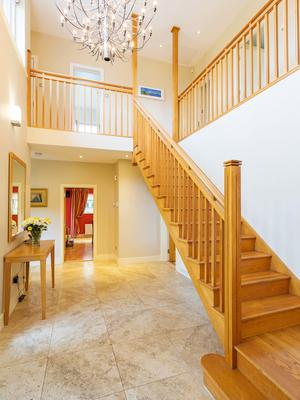The American Oak staircase sets the tone in the hall