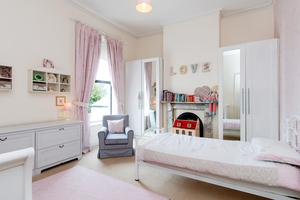One of the generously sized bedrooms