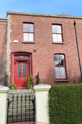 18 Brighton Square: the redbrick house was built in 1868.