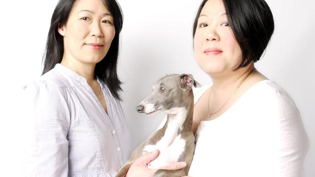 'I'm a self-confessed crazy dog lady and I love my dogs, but they're not babies,' says Christine Chau (pictured right with her sister Jenny)