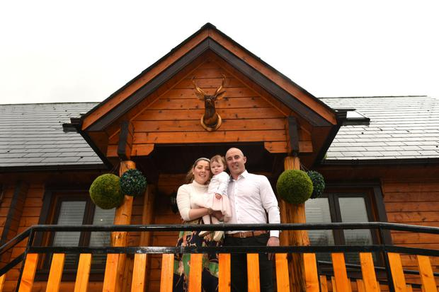 Donna Breen and Kieran Bergin with their one-year-old daughter Ruby-Anna outside Belleview Lodge, Co Tipperary. Photo: Bryan Meade