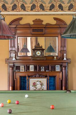 The hardwood-carved fireplace surround
