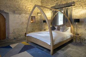 The grand floor bedroom with an unusual shaped bed