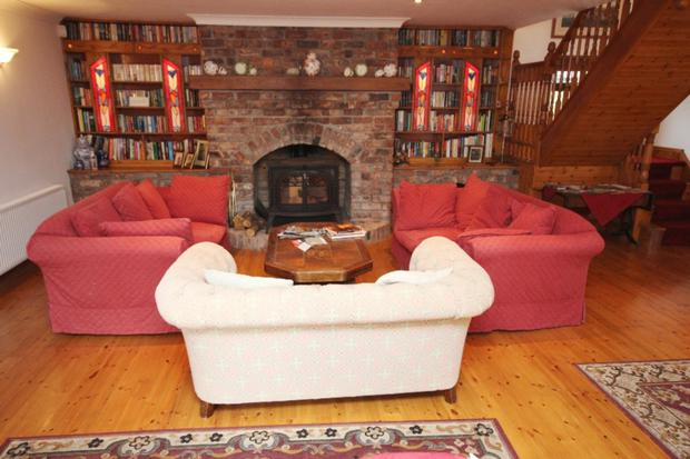 The sitting room has a wood-burning stove