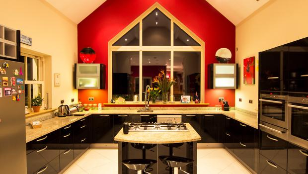 The kitchen area has a partly vaulted ceiling with skylights with a huge window as the main feature