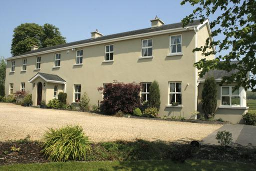 The large, modern house is set on 1.6 acres, close to Knockanally Golf and Country Club