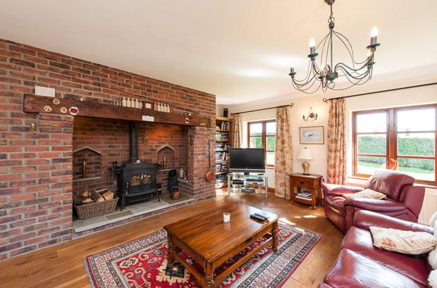 The family room with brick fireplace