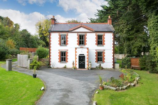 Mature trees flank this period farmhouse-style residence, close to the centre of Dundrum