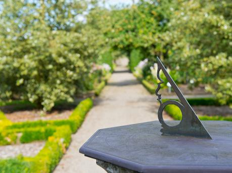 An ornate sun dial punctuates the pathways which criss-cross Ballindoolin gardens