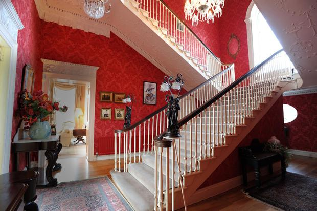 The grand hall and staircase of Firville