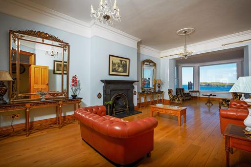 The generously proportioned living room at the front of the house enjoys uninterrupted sea views