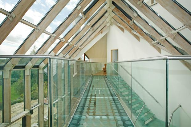 The overhead glass walkway allows you to experience the views at top floor level