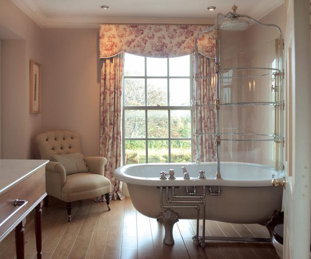 A stand alone period style tub graces the bathroom at Bishop's Vale