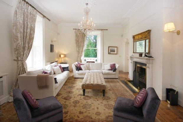 The drawing room with white marble fireplace