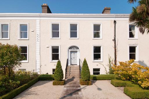 A formal front garden and granite steps help make a grand entrance for Number 11