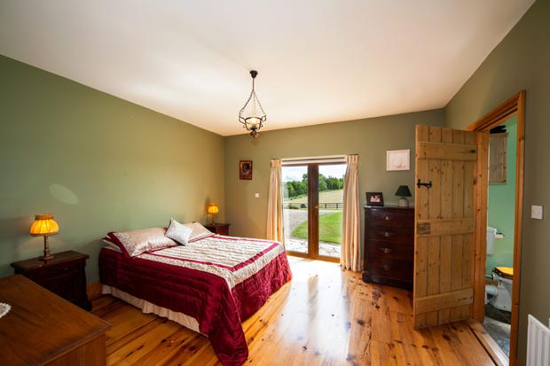 The master bedroom with ensuite has double doors leading into the expansive gardens