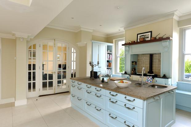 The spacious kitchen has a feeling of country charm