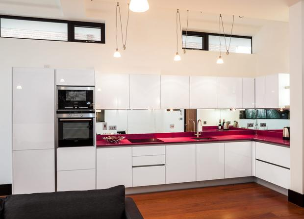 The kitchen with striking pink counter top