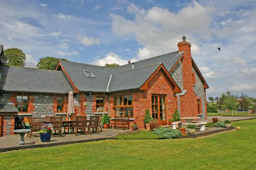 Hickory Hollow stands on seven acres including landscaped gardens and a stone courtyard