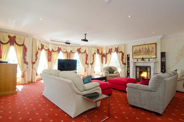 The generous living room is perfect for entertaining