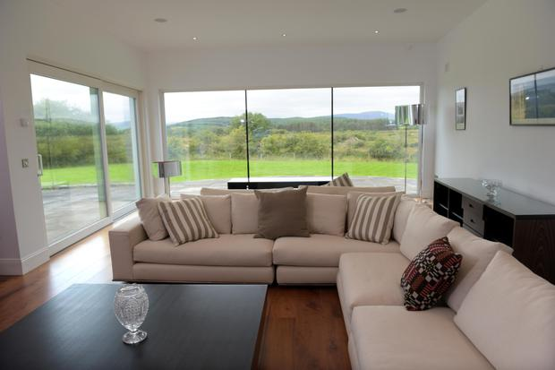 A modern living room with surround views.