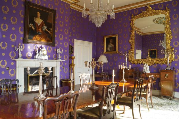 The purple wallpaper in one of the rooms of Capard House