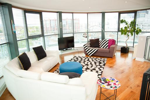 The curved sitting room South Lotts Road, with views across the city