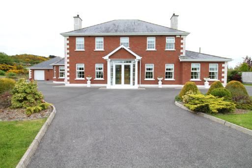 The six-bedroom home enjoys a pastoral setting and offers 3,657 sq ft of accommodation